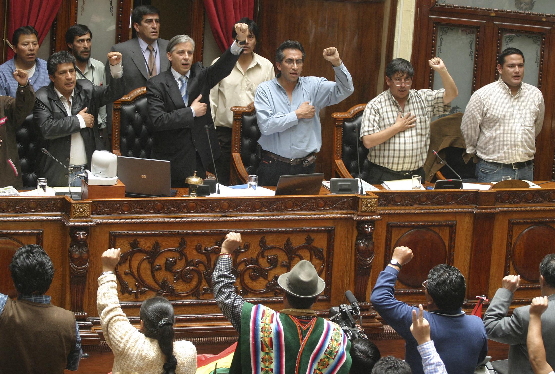 Deputy Novillo, Vice President Linera, Deputy Torrico and Senator Fernandez celebrate the passage of a law in La Paz