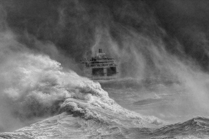 Ferry leaving Newhaven harbour in storm, East Sussex, England