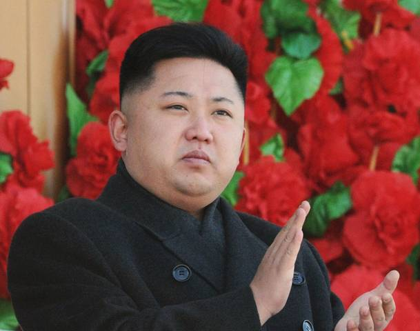 North Korean leader Kim Jong-Un claps his hands during a military parade in Pyongyang