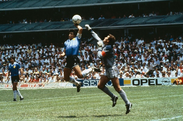 Argentinas-Diego-Maradona-scores-their-first-goal-with-his-hand-over-Peter-Shilton-of-England-1753130