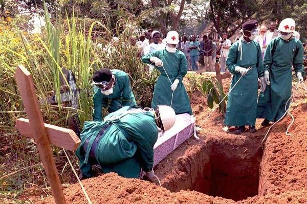 Red Cross workers burry 14 May Italian nun Dinaros