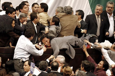 Congressional lawmakers from the PAN pull down a lawmaker of the PRD in Mexico City