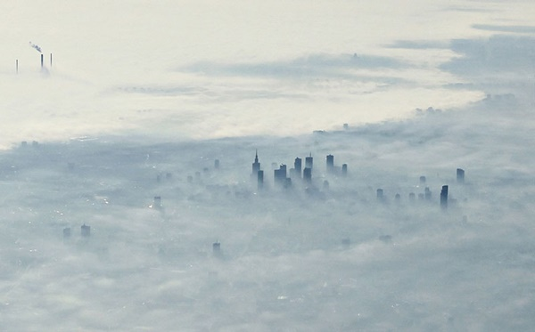 warsaw-poland-covered-in-fog-from-an-airplane-aerifal-from-above-06