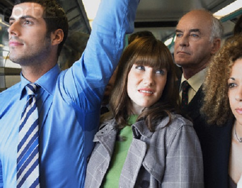 Commuter Standing by Man's Wet Armpit on Train --- Image by © moodboard/Corbis