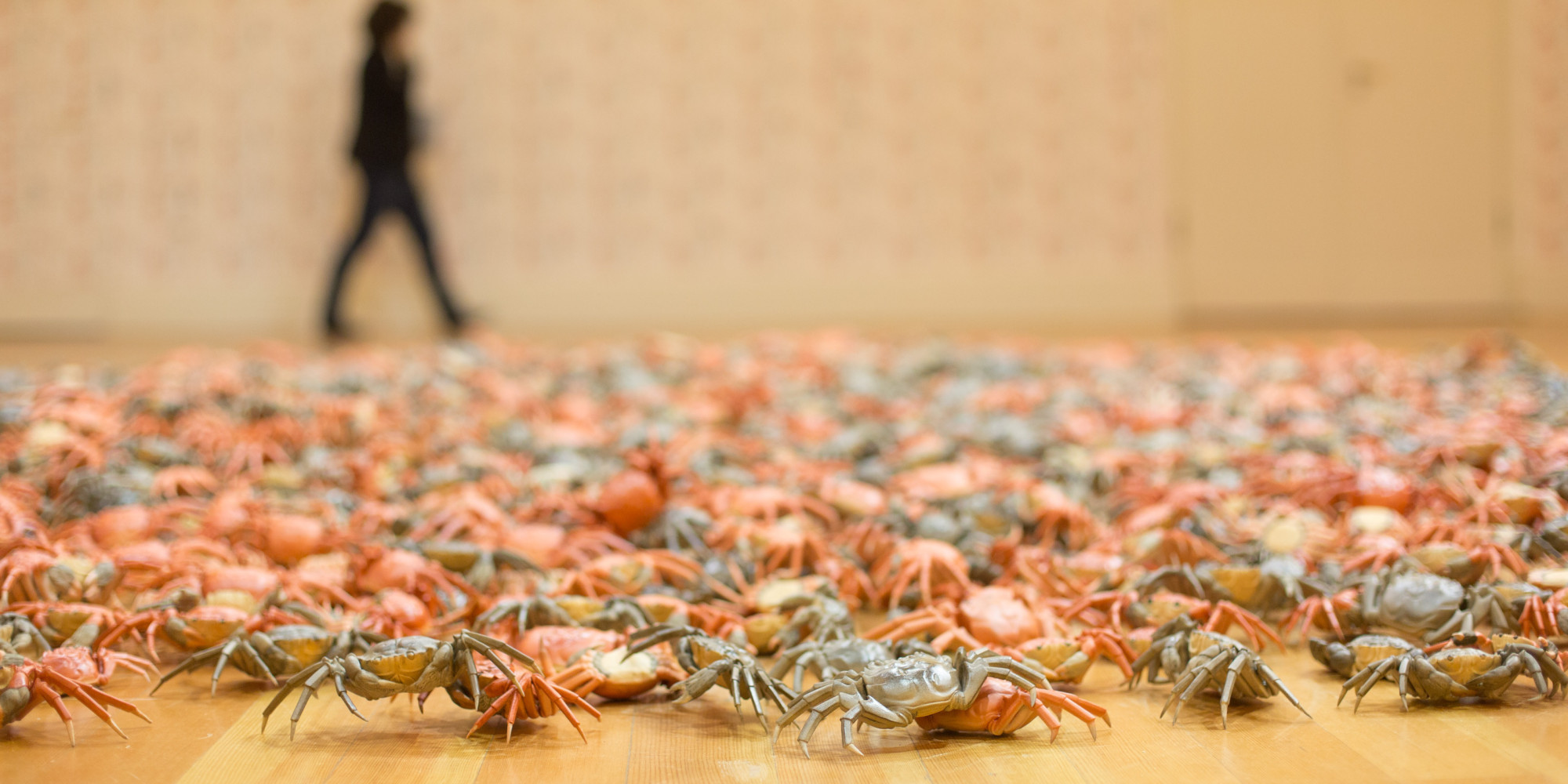 BERLIN, GERMANY - APRIL 02:  A visitor passing by the work 'He Xie' , or  'Crabs'  at the press preview for Chinese artist Ai Weiwei 'Evidence' exhibition at Martin Gropius Bau on April 2, 2014 in Berlin, Germany. The exhibition opens to the public on April 3 and runs until July 7, 2014. (Photo by Christian Marquardt/WireImage)