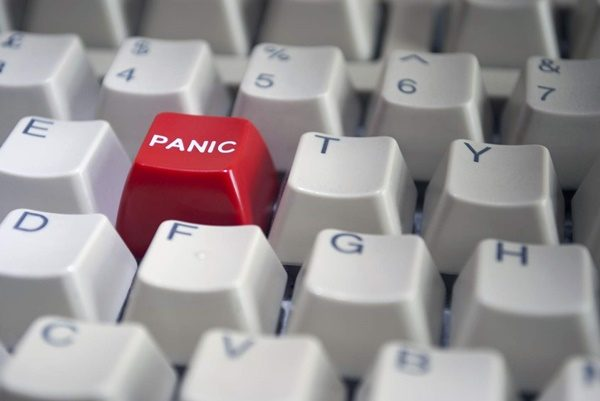 Computer keyboard with red panic button