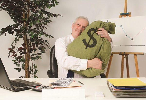 Bank Manager Hugging Bag Of Money