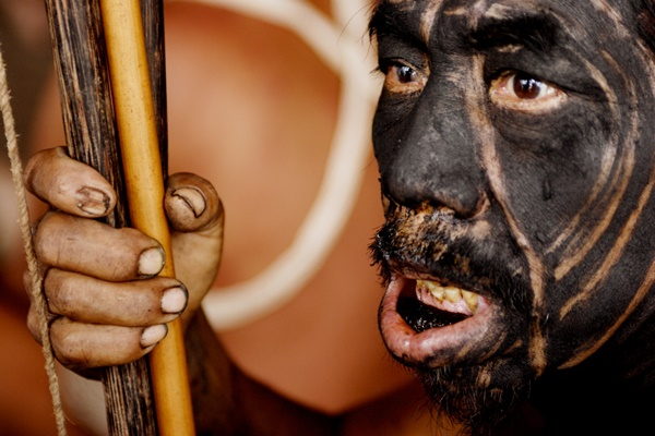 Yanomami shaman watching a tribal dance.