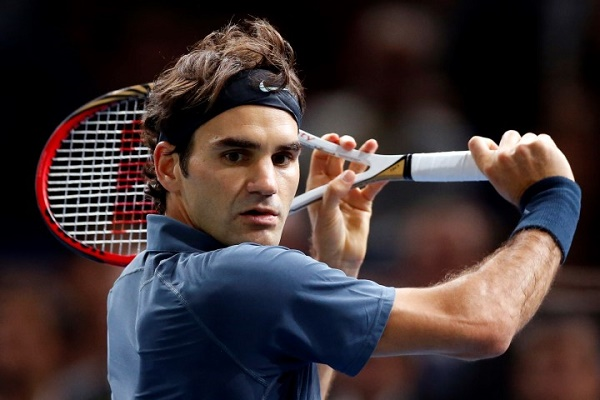 Federer of Switzerland prepares to return to Anderson of South Africa at the Paris Masters men's singles tennis tournament at the Palais Omnisports of Bercy in Paris