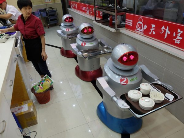 Three-robots-behind-the-counter