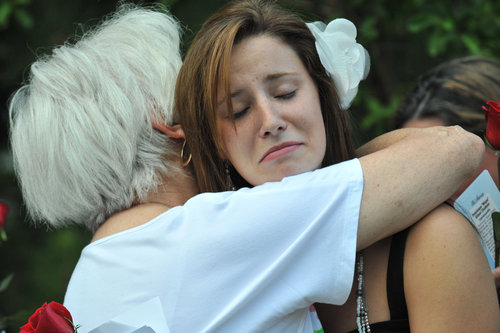 110722 Lawrenceville : Alex Page (right), 19, oldest daughter of Nique Leili, gets a hug from her grand mother and mother of Nique Leili, Harriett Garrett during the candlelight vigil for Nique Leili, whose body was discovered Saturday morning in the Oak Village subdivision in Lawrenceville on Tuesday, July 22, 2011 Hyosub Shin, hshin@ajc.com