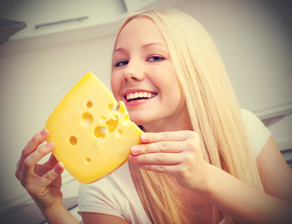 Woman-holding-cheese