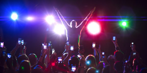 Audience photographing musician on stage