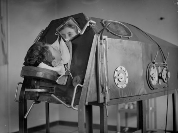 1938:  A patient lying in an artificicial respiration machine called an iron lung.  (Photo by London Express/Getty Images)