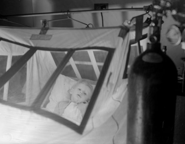 circa 1937:  A young patient, Gerald Blackburn, in an oxygen tent at Princess Beatrice Hospital.  (Photo by London Express/Getty Images)