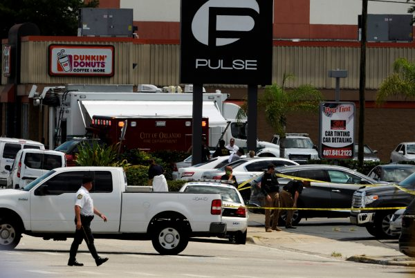 Police continue to investigate a shooting at the Pulse night club following an early morning shooting attack in Orlando, Florida, U.S June 12, 2016.  REUTERS/Steve Nesius     TPX IMAGES OF THE DAY      - RTX2FTI7