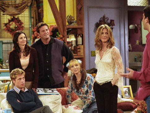 "Brad Pitt, front left, joins the cast of NBC's television show ""Friends"" as a mystery guest on their Thanksgiving episode to air Thursday, Nov. 22, 2001. Cast members, from left, Courteney Cox Arquette, Matthew Perry, Lisa Kudrow and Jennifer Aniston, look at David Schwimmer, right. (AP Photo/NBCMV/Warner Bros., Danny Feld)   Original Filename: FRIENDS_THANKSGIVING_WXS105.jpg"