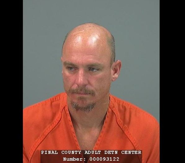 This image provided by the Pinal County Sheriff's office shows the booking photo of Joseph Andrew Dekenipp an inmate of the Pinal County Adult Detention Center who escaped by climbing two walls and crawling through razor wire and was reportedly meeting his sweetheart on Valentine's Day. He was arrested in the town of Coolidge, a few hours after he escaped Friday Feb. 14, 2014. (AP Photo/Pinal County Sheriff)