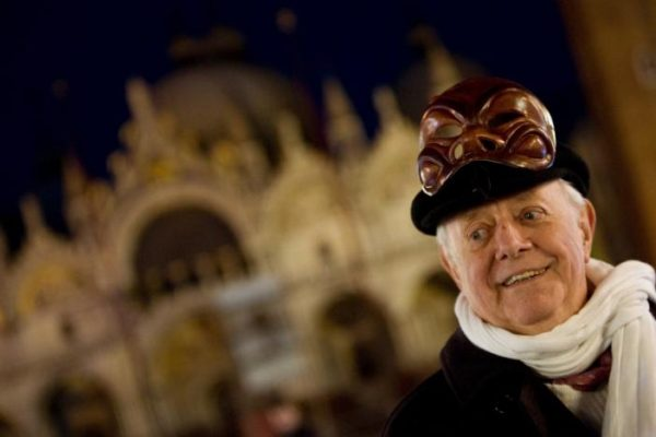 Dario Fo, Italy's Nobel laureate playwright, smiles as he poses with a mask in front of St Mark basilic during the Venetian Carnival in Venice