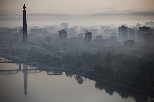 on-the-other-side-of-the-city-the-558-feet-tall-juche-tower-looms-above-the-taedong-river