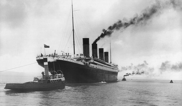 The White Star Liner RMS Titanic, built by Harland & Wolff in Belfast, 4th February 1912, aided by four tugs preparing to leave for Southampton for her maiden voyage to New York on April 10th 1912. The steamship sank on April 15th 1912 off the coast of New Foundland after striking an iceberg with the loss of 1,635 passengers and crew, (Photo: Universal Images Group/Getty Images)