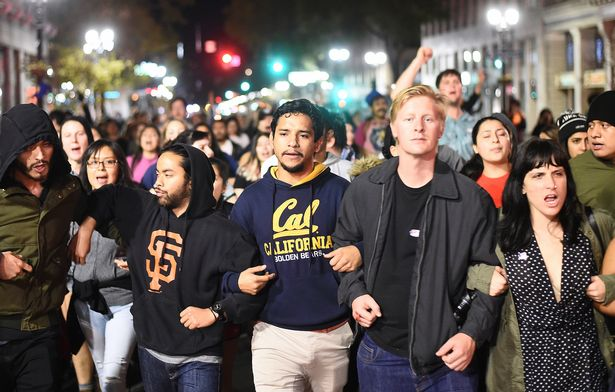 Protesters-against-president-elect-Donald-Trump-march-through-Oakland