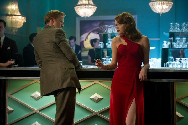"RYAN GOSLING as Sgt. Jerry Wooters and EMMA STONE as Grace Faraday in Warner Bros. Pictures' and Village Roadshow Pictures' drama ""GANGSTER SQUAD,"" a Warner Bros. Pictures release."
