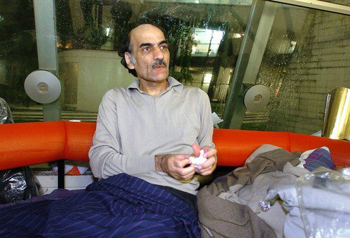 "Mehran Karimi Nasseri awakes early in the morning 12 August 2004 in the terminal one of Paris Charles De Gaulle airport. Known as ""Sir Alfred Mehran"", Mehran Karimi Nasseri is a 59 year-old Iranian refugee who has been living in Roissy for 16 years, and whose life has inspired American film director Steven Spielberg for the character of the protagonist in the movie ""The Terminal"".    AFP PHOTO STEPHANE DE SAKUTIN, Image: 73098016, License: Rights-managed, Restrictions: , Model Release: no, Credit line: Profimedia, AFP"