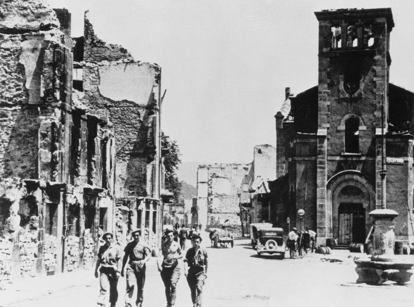 Troops Walking by Demolished Buildings
