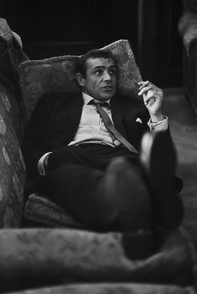28th October 1963:  British actor Sean Connery lounges on a sofa with a cigarette. He is in London during filming of the thriller 'Woman of Straw' with Gina Lollobrigida.  (Photo by Bob Haswell/Express/Getty Images)