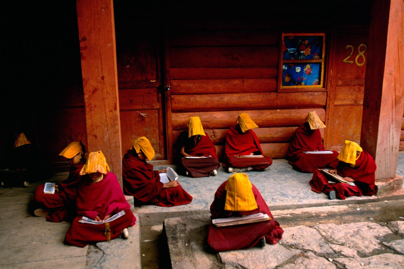 Young monks study Buddhist scripture at a monastery in Lithang, Tibet, 1999.