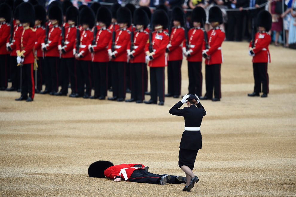 A Guardsman faints at Horseguards Parade for the annual Trooping the Colour ceremony in central London, Britain June 11, 2016.