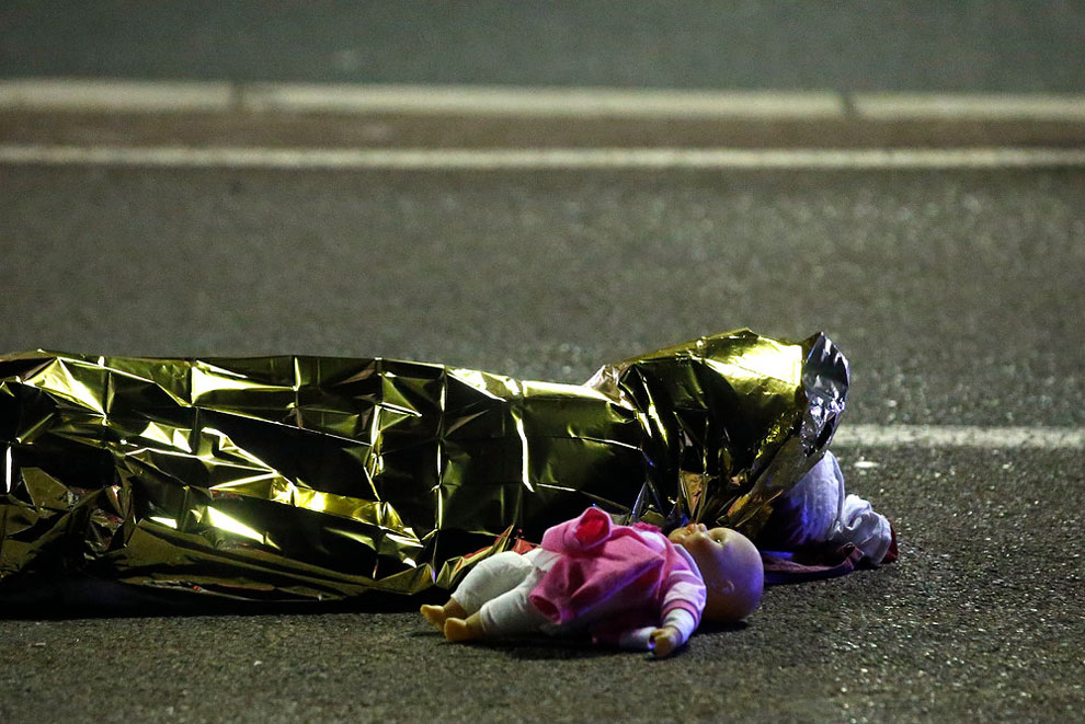 A body is seen on the ground July 15, 2016 after 86 people were killed in Nice, France,