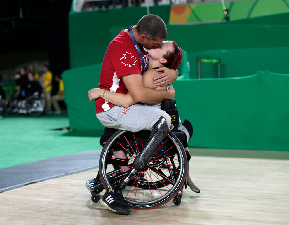 Adam Lancia embraces his wife Jamey Jewells of Canada after her women's wheelchair basketball playoff match against China at the Rio Paralympics September 16, 2016.