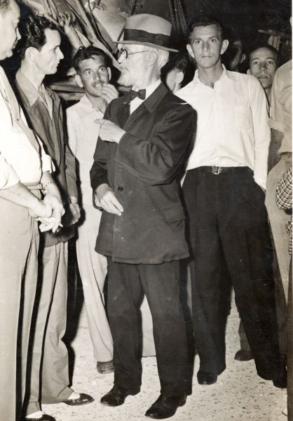 """Van Cosal Carl Tanzler tlaking to Earl Adams and, Bennie Sawyers on the left in 1940. Photo Gift Clarke Means. """""""