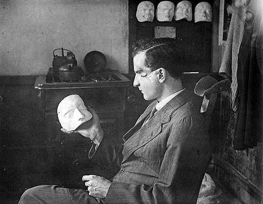 patient-at-wandsworth-examines-his-mask-image-iwm