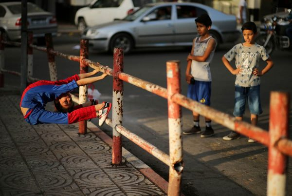 a-palestinian-boy-who-is-nicknamed-spiderman-and-hopes-to-break-the-guinness-world-records-with-his-bizarre-feats-of-contortion-demonstrates-acrobatics-skills-in-gaza-city