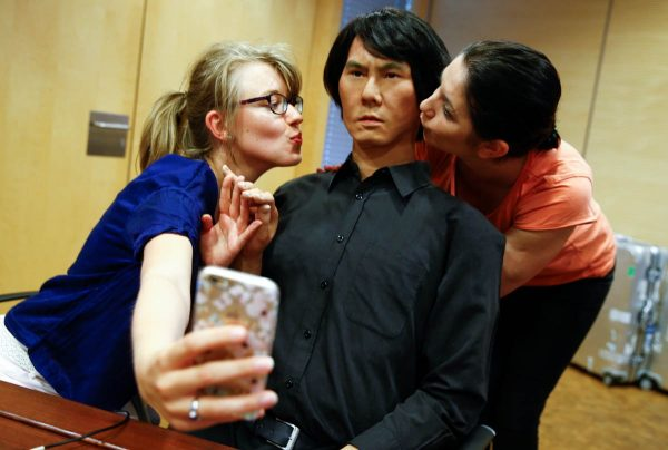 employees-of-germanys-biggest-retailer-metro-ag-take-a-selfie-as-they-kiss-hi-4-a-life-size-humanoid-robot-in-duesseldorf-germany