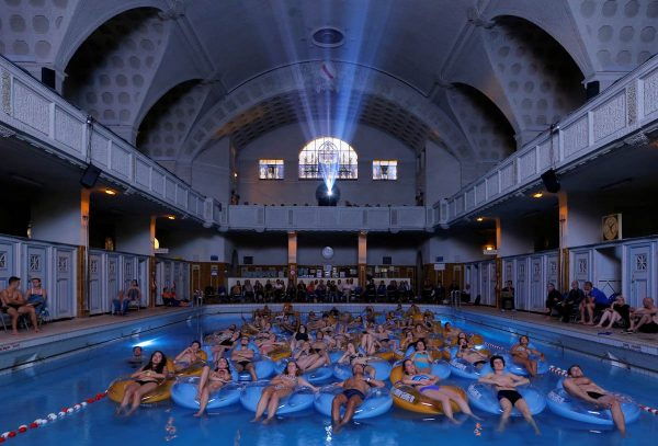people-attend-the-screening-of-the-film-jaws-at-the-strasbourg-public-baths-during-the-european-fantastic-film-festival-in-strasbourg-france