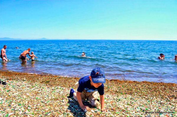 vodka-bottle-pebbles-glass-beach-ussuri-bay-russia-7