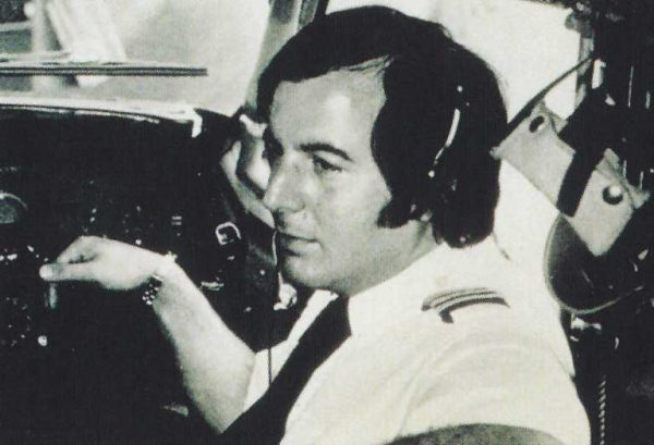 Frank Abagnale as pilot in cockpit of commercial airplane