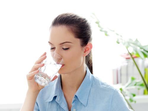 woman-drinking-glass-water-morning