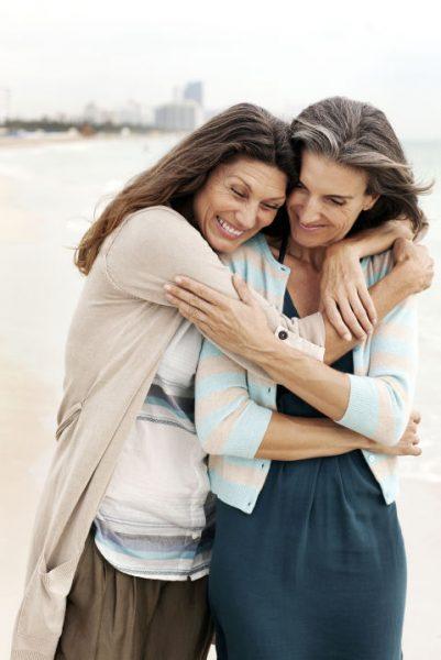 women-hugging