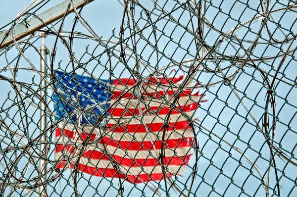 American-fleg-behind-a-prison-fence
