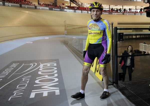 French cyclist Robert Marchand, aged 102, walks onto the track at the indoor Velodrome National in Montigny-les-Bretonneux