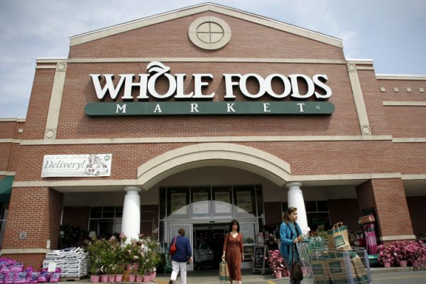 In this May 3, 2011 photo, shoppers depart a Whole Foods Market store location in Providence, R.I. Whole Foods Market Inc. reports quarterly financial earnings Wednesday, May 4, 2011, after the market close.   (AP Photo/Steven Senne)