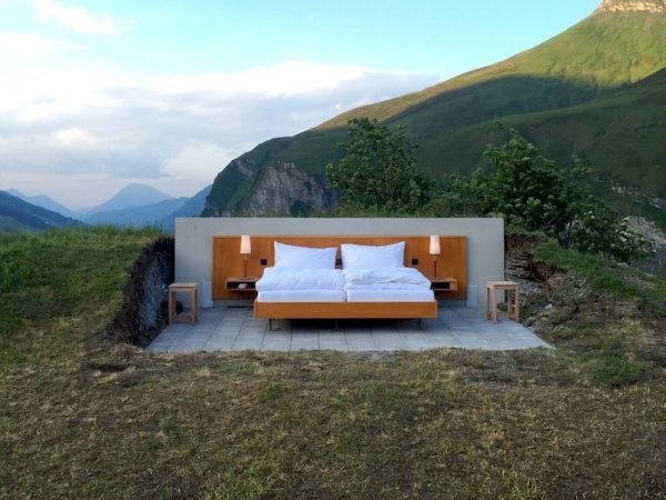 the-hotelhas-no-walls-roof-or-bathroom--only-a-queen-bed-with-a-pair-of-nightstands-and-lamps-a-public-bathroom-is-about