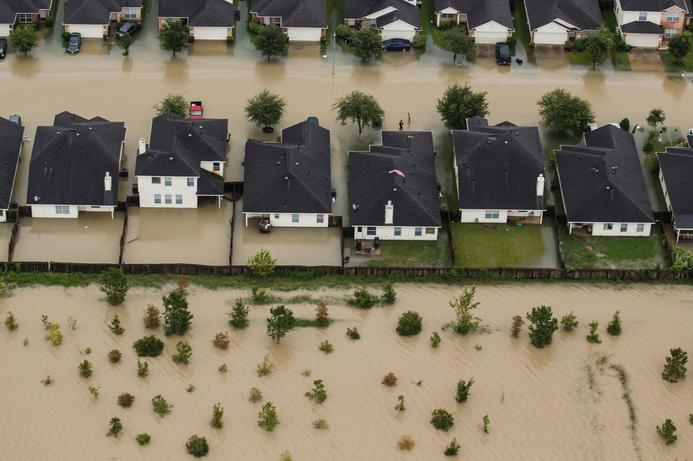 HOUSTON, TEXAS -- TUESDAY, AUGUST 29, 2017: Residential neighborhoods near the Interstate 10 sit in floodwater in the wake of Hurricane Harvey on August 29, 2017  in Houston, Texas. (Marcus Yam / Los Angeles Times)