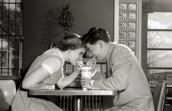 laughing-couple-sharing-a-drink-h-armstrong-robertsclassicstock