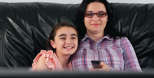 Young mother and daughter watching TV 590x300